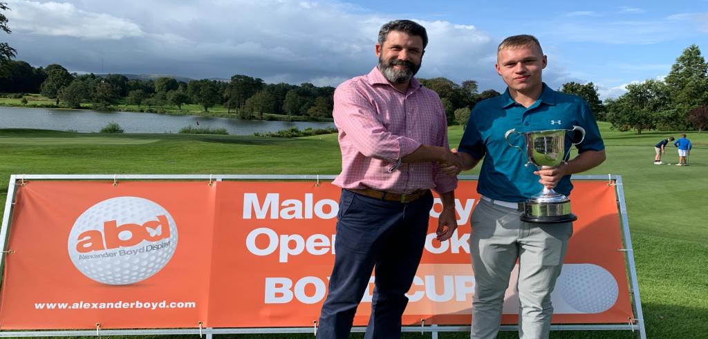 Alexander Boyd Displays staff member presents Boyd Cup to winner